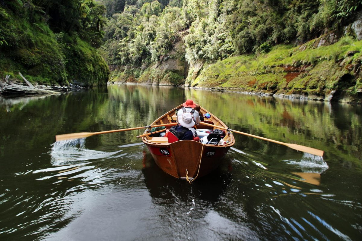 A wooden river dory on the Whanganui River